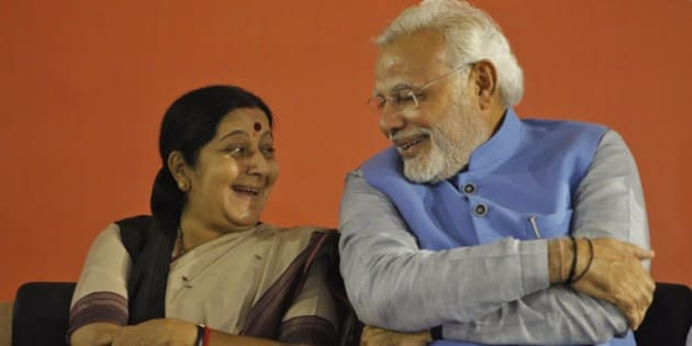 Opposition Bharatiya Janata Party (BJP) leader and India's next prime minister Narendra Modi, right, has a laugh with party leader Sushma Swaraj during a press conference at the party headquarters in New Delhi, India, Saturday, May 17, 2014. Thousands of cheering supporters welcomed Modi on his arrival in the capital Saturday after leading his party to a staggering victory in national elections. Modi and his BJP wiped out the Congress party that dominated Indian politics for all but a decade since the country gained freedom from British rule in 1947. (AP Photo/Altaf Qadri)