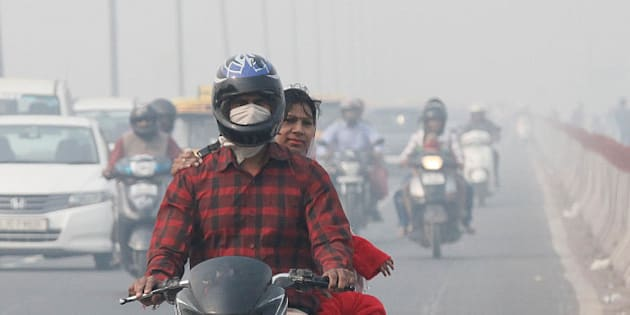 NEW DELHI, INDIA - NOVEMBER 13: Commuters drive past as roads were seen covered in smog, on November 13, 2015 in New Delhi, India. Pollution soared to hazardous levels in Delhi on the night of Diwali, reaching 40 times the limit recommended by the World Health Organisation. Air pollution is also a leading cause of premature death in India, with about 620,000 people dying every year from pollution-related diseases. Experts say these particulate matters which are way above the permissible limit are extremely dangerous for people suffering from asthma and other respiratory and cardiac problems, and also for children and the elderly. (Photo by Raj K Raj/Hindustan Times via Getty Images)