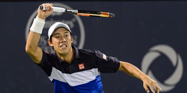 MONTREAL, ON - AUGUST 13:  Kei Nishikori of Japan hits a return against David Goffin of Belgium during day four of the Rogers Cup at Uniprix Stadium on August 13, 2015 in Montreal, Quebec, Canada.  Kei Nishikori defeated David Goffin 6-4, 6-4.  (Photo by Minas Panagiotakis/Getty Images)