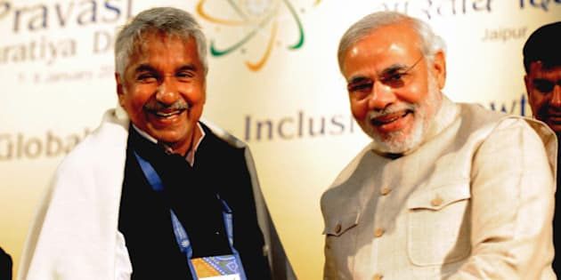 Gujarat Chief minister Narendra Modi (R) shakes hands with Kerala Chief Minister Oommen Chandy during the 10th Pravasi Bharatiya Divas 2012 (Overseas Indian Conference) in Jaipur on January 9, 2012. Some 1.600 delegates from 50 countries attend the annual gathering of overseas Indian where Trinidad and Tobago Prime Minister Kamala Persd Bissessar is present as the chief guest. AFP PHOTO/ RAVEENDRAN (Photo credit should read RAVEENDRAN/AFP/Getty Images)