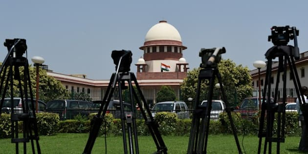Camera tripods are lined up outside the Supreme court during the judgement on 'Santhara' in New Delhi on August 31, 2015.  India's Jain community scored a legal victory when the Supreme Court temporarily lifted a ban on the traditional ritual of Santhara, or fasting to death.     AFP PHOTO / MONEY SHARMA        (Photo credit should read MONEY SHARMA/AFP/Getty Images)