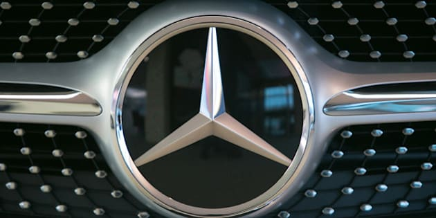 The Mercedes-Benz logo sits on a S-Class automobile in the center of excellence showroom at Daimler AG's Mercedes-Benz factory in Sindelfingen, Germany, on Monday, Nov. 23, 2015. Daimler's Mercedes-Benz brand is poised to overtake Volkswagen AG's Audi this year as the world's second-largest maker of luxury cars, driven by a revamped lineup of sport-utility vehicles and the flagship S-Class sedan. Photographer: Krisztian Bocsi/Bloomberg via Getty Images