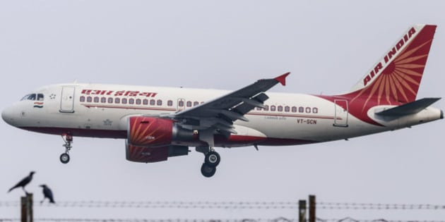 An Airbus SAS A321 aircraft operated by Air India Ltd. approaches to land at Chhatrapati Shivaji International Airport in Mumbai, India, on Monday, Oct. 26, 2015. Air India is the nation's third biggest airline by market share. Photographer: Dhiraj Singh/Bloomberg via Getty Images