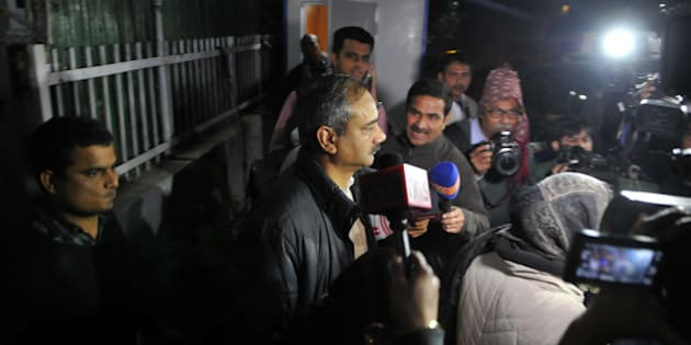 NEW DELHI, INDIA - DECEMBER 15: CBI team taking Rajendra Kumar Gupta for questioning during the raid at his house at New Friends Colony on December 15, 2015 in New Delhi, India. CBI today set off a political storm when it carried out raids in 14 places in a corruption case against Rajendra Kumar, Delhi Chief Minister Arvind Kejriwal's Principal Secretary and six others. (Photo by Abhinav Saha/Hindustan Times via Getty Images)