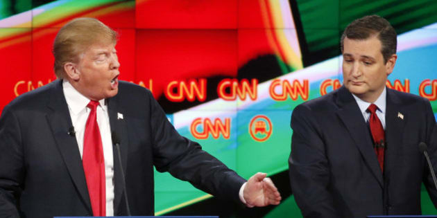 Donald Trump, left, responds forcefully to Jeb Bush (not seen) as Ted Cruz looks on during the CNN Republican presidential debate at the Venetian Hotel & Casino on Tuesday, Dec. 15, 2015, in Las Vegas. (AP Photo/John Locher)