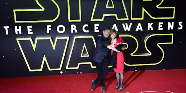 US actor Mark Hamill and his wife Marilou York attend the opening of the European Premiere of 'Star Wars: The Force Awakens' in central London on December 16, 2015. Ever since 1977, when 'Star Wars' introduced the world to The Force, Jedi knights, Darth Vader, Wookiees and clever droids R2-D2 and C3PO, the sci-fi saga has built a devoted global fan base that spans the generations. 