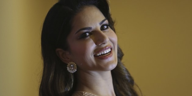 """Bollywood star Sunny Leone poses after a press conference to promote her upcoming movie """"Kuch Kuch Locha Hai"""" in Hyderabad, India, Thursday, May 7, 2015. (AP Photo/Mahesh Kumar A.)"""