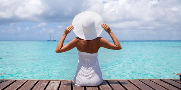 healthy tan elegant woman in white relaxing on tropical summer vacation in Tahiti, French Polynesia