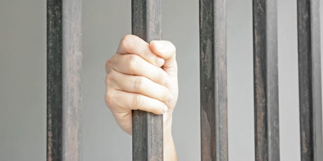 Hands of a woman in jail