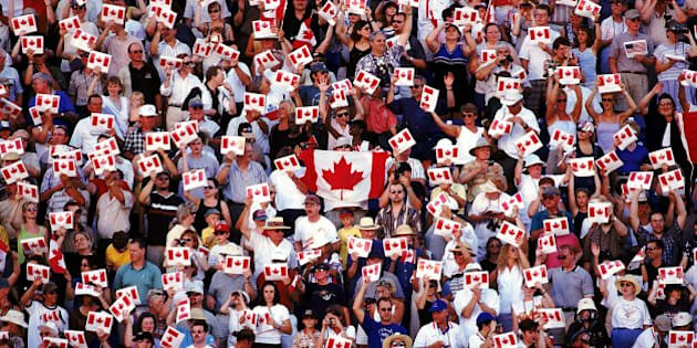 23 Jul 1999: A view of fans waving Canadian flags in the opening ceremony of the Pan-American Games at Winnipeg, Manitoba, Canada. Mandatory Credit: Donald Miralle  /Allsport