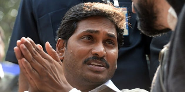 YSR Congress chief, Jagan Mohan Reddy gestures during a protest against the bifurcation of Andhra Pradesh, in New Delhi on February 17,  2104.   YSR Congress, which is stiffly opposing the bifurcation of Andhra Pradesh, sought Left support for stalling the creation of Telangana state and asking all opposition parties to oppose its creation.  AFP PHOTO/ SAJJAD HUSSAIN        (Photo credit should read SAJJAD HUSSAIN/AFP/Getty Images)
