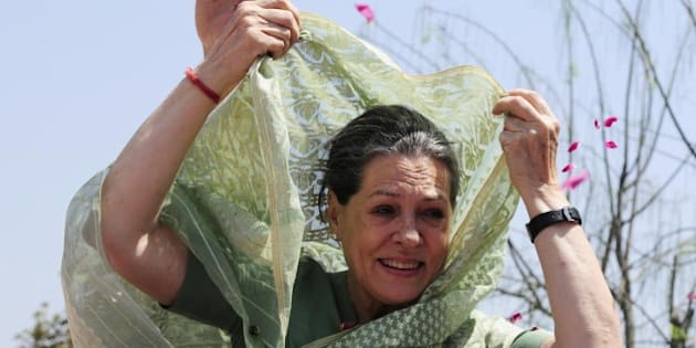 RAEBARELI, INDIA- APRIL 2: UPA Chairperson and Congress President Sonia Gandhi being welcomed by the supporters during road show before filing her nomination for Lok Sabha election on April 2, 2014 in Raebareli, India. Gandhi, 67, who will be seeking re-election from the seat, which been a Nehru-Gandhi family bastion since the 1960s. Indira Gandhi won it for the first time in 1967, taking over after the death of her husband Feroz, who was also an MP from here. Gandhi is a three time MP from Rae Bareli, including once elected in a by-election in 2006. (Photo by Deepak Gupta/Hindustan Times via Getty Images)