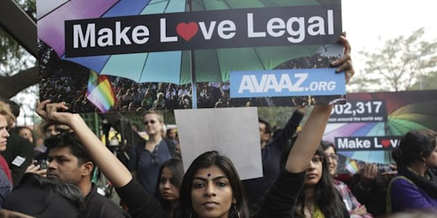 Indian gay rights activists hold placards during a protest against a Supreme Court verdict that upheld section 377 of the Indian Penal Code that criminalizes homosexuality in New Delhi, India, Sunday, Dec. 15, 2013. Hundreds of gay rights activists gathered in India's capital and other cities across the country on Sunday to protest a decision by India's top court to uphold a law that criminalizes gay sex. (AP Photo/Tsering Topgyal)