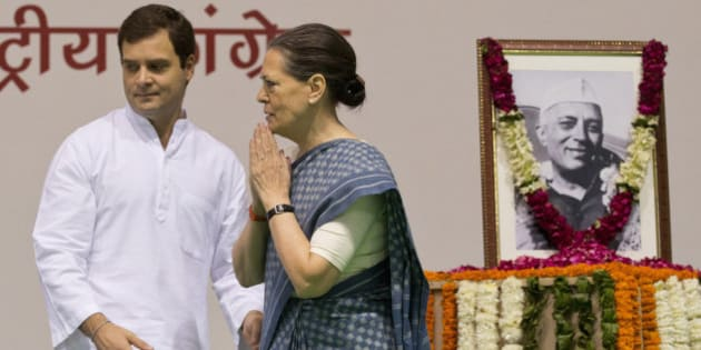 Congress party President Sonia Gandhi, right, and her son and Vice President Rahul Gandhi arrive for celebrations marking the 125th birth anniversary of the first Indian Prime Minister Jawaharlal Nehru, portrait seen, in New Delhi, India, Thursday, Nov. 13, 2014.  Nehru is the great-grandfather of Rahul Gandhi. His birth anniversary falls on Nov. 14. (AP Photo/Saurabh Das)
