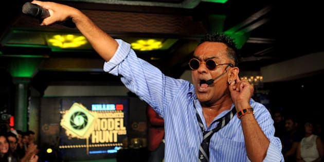 Indian fusion artist and film playback artist Remo Fernandes performs during an event for the Mandate Model Hunt contest  in Mumbai on May 4, 2013. AFP PHOTO/ STR        (Photo credit should read STRDEL/AFP/Getty Images)