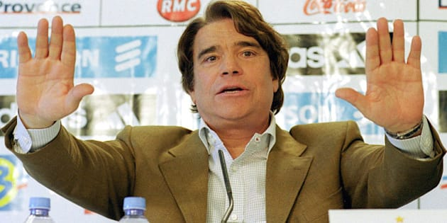 ** FILE ** Former flamboyant businessman and leftist politican Bernard Tapie is seen in Marseille during a press conference in this April 9, 2001 file photo. An appeal court in Paris on Friday, Sept. 30, 2005 ordered the French government and formerly state-owned bank Credit Lyonnais, now called Le Credit Lyonnais, or LCL, to pay 135 million (US$163 million) in compensation over the 1994 sale of sportswear maker Adidas. Credit Lyonnais, since privatized and acquired by rival bank Credit Agricole SA, and the CDR government agency set up to take over its bad debts, were ordered to pay the compensation to Bernard Tapie, Adidas' former owner. (AP Photo/Claude Paris, file)