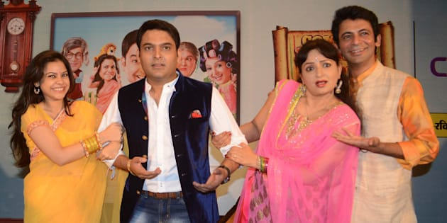 Indian comedy actor  Kapil Sharma (C),  Sunil Grover (R), actresses Upasana Singh (2R), and Sumona Chakravarti (L) pose during a press conference at a hotel in Amritsar on June 8, 2013. The entertainers visited the Punjabi city to promote a new TV series Comedy Nights with Kapil which will be telecasting  on  Colour TV Channel on June 22. AFP PHOTO/ NARINDER NANU        (Photo credit should read NARINDER NANU/AFP/Getty Images)