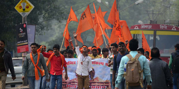 Indian Hindu activists from the Shiv Sena group march as they demand the construction of a Hindu temple in Ayodhya, on the anniversary of the destruction of a 16th century Muslim mosque at Ayodhya, in Allahabad on December 6, 2015.  In 1992 tens of thousands of Hindu fundmentalists destroyed the historic Babri Masjid, in Ayodhya in Uttar Pradesh state, because it was thought to be birth place of the Hindu deity Ram. AFP PHOTO/SANJAY KANOJIA / AFP / Sanjay Kanojia        (Photo credit should read SANJAY KANOJIA/AFP/Getty Images)