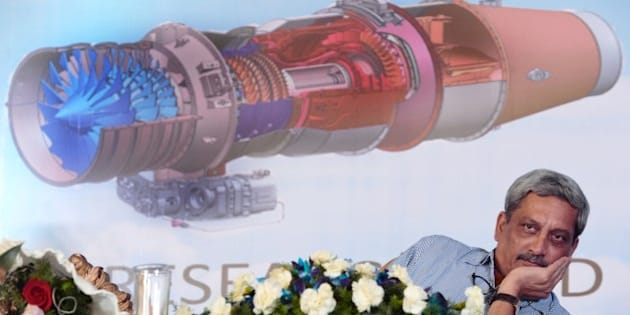 Indian Defense Minister Manohar Parrikar attends the inaugural run of India's indegenous 25kN thrust class, Hindustan Turbo Fan Engine (HTFE-25) in Bangalore on December 14, 2015.  The Aero Engine Research and Design Centre (AERDC) of HAL has designed and developed the HTFE-25kN engine for basic military trainer aircraft.  AFP PHOTO/ Manjunath KIRAN / AFP / Manjunath Kiran        (Photo credit should read MANJUNATH KIRAN/AFP/Getty Images)