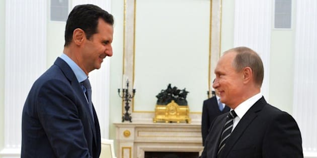 Russian President Vladimir Putin (R) shakes hands with his Syrian counterpart Bashar al-Assad (L) during their meeting at the Kremlin in Moscow on October 20, 2015. Syria's embattled President Bashar al-Assad made a surprise visit to Moscow on October 20 for talks with Russian President Vladimir Putin, his first foreign trip since the conflict erupted in 2011.  AFP PHOTO / RIA NOVOSTI / KREMLIN POOL / ALEXEY DRUZHININ        (Photo credit should read ALEXEY DRUZHININ/AFP/Getty Images)