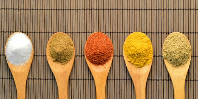 Indian Spicesspoon woodentraditional cuisine foodwood color taste Indiachili cumin turmeric salt coriander powder