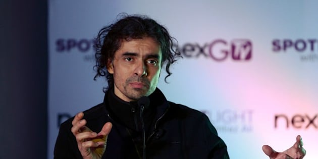 Bollywood director Imtiaz Ali gestures as he speaks during an event to launch new project 'SPOTLight' by nextGTV, in New Delhi on December 21, 2015.  AFP PHOTO / Money SHARMA / AFP / MONEY SHARMA        (Photo credit should read MONEY SHARMA/AFP/Getty Images)