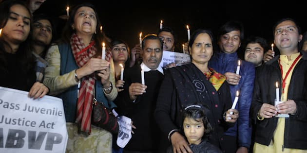 NEW DELHI, INDIA - DECEMBER 21: Parents of Nirbhaya alongwith activists during a protest against the release of juvenile convict of the 16 December Gang-rape on December 21, 2015 in New Delhi, India. As pressure mounted on it for early passage of the Juvenile Justice Bill, government today listed the crucial legislation in Rajya Sabha for passage tomorrow and blamed Congress for blocking it in the past due to its obstructionist politics even when it was listed on 15 occasions. (Photo by Sushil Kumar/Hindustan Times via Getty Images)