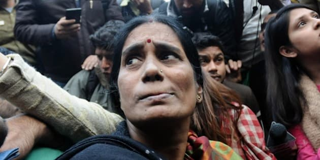 NEW DELHI, INDIA - DECEMBER 21: The mother of Indian gang-rape victim 'Nirbhaya' (C) talks to the media as she attends a rally held to protest the release of a juvenile rapist in New Delhi on December 21, 2015. India's Supreme Court rejected an appeal against the release of the youngest convict in an infamous fatal gang-rape, sparking fury from the victim's parents who said the ruling was a betrayal. (Photo by Vinod Singh/Anadolu Agency/Getty Images)