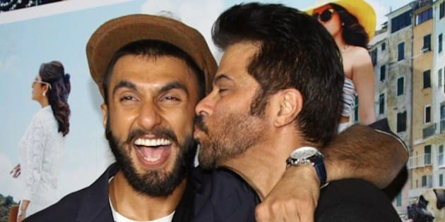 Indian Bollywood actors Anil Kapoor (R) and Ranveer Singh pose during the trailer showing of upcoming Hindi comedy-drama film 'Dil Dhadakne Do' directed by Zoya Akhtar and produced by Farhan Akhtar and Ritesh Sidhwani in Mumbai on April 15, 2015.   AFP PHOTO        (Photo credit should read STR/AFP/Getty Images)