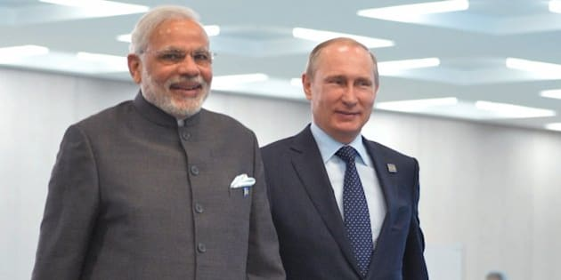 Indian Prime Minister Narendra Modi, left, Russian President Vladimir Putin walk during the Shanghai Cooperation Organization (SCO) summit in Ufa, Russia, Friday, July 10, 2015. (RIA Novosti Pool Photo via AP)