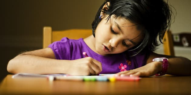 Portrait of a Girl Child Drawing. The photograph was taken to show show the importance of art education in children.