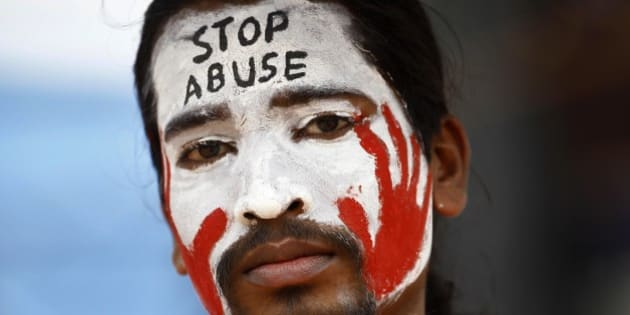 An Indian protester with a slogan painted on his face participates in a demonstration to protest against police inaction after a six-year-old was allegedly raped in a school, in Bangalore, India, Sunday, July 20, 2014. More than a hundred protesters gathered Sunday and demanded that police arrest those involved in the July 2 incident, which was reported only this past week. The rape has raised questions about the safety of India's schoolchildren and sparked nationwide outrage over rampant sexual violence against girls and women. (AP Photo/Aijaz Rahi)
