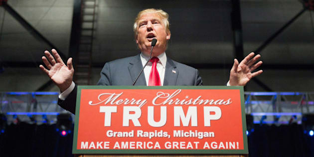 GRAND RAPIDS, MI - DECEMBER 21:  Republican presidential candidate Donald Trump speaks to guests at a campaign event on December 21, 2015 in Grand Rapids, Michigan. The full-house event was repeatedly interrupted by protestors. Trump continues to lead the most polls in the race for the Republican nomination for president.  (Photo by Scott Olson/Getty Images)