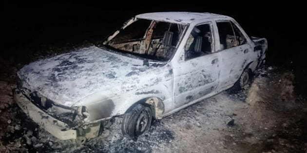 A burned down car remains at the crime scene where six people were executed by gunmen in Tetitlan de Las Limas, Chilapa, Guerrero state, Mexico on November 10, 2015.  Six people were killed in a violent Mexican town of Guerrero (south), five of the victims belonged to the family of a controversial former chief of police and including two children aged seven and one years and their mother, said Tuesday the state police .This brutal murder occurred on Monday joined the Sunday day of violence in Guerrero, where 16 people were killed, 12 in a clash in a cockfight and four in a sports after a football match. AFP PHOTO/ STR        (Photo credit should read STR/AFP/Getty Images)