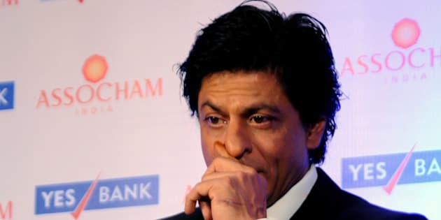 Indian Bollywood actor Shah Rukh Khan attends the launch of an ASSOCHAM (Associated Chambers of Commerce and Industry of India) coffee table book in Mumbai on November 23, 2015. AFP PHOTO / AFP / STR        (Photo credit should read STR/AFP/Getty Images)