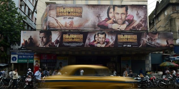 Posters for recently-released film 'Bajrangi Bhaijaan' staring Bollywood actor Salman Khan are seen in Kolkata on July 27, 2015. Khan retracted comments urging India's top court on July 26 to spare the life of a convicted bomb plotter due to be hanged this week, after his appeal sparked uproar. AFP PHOTO/ Dibyangshu Sarkar        (Photo credit should read DIBYANGSHU SARKAR/AFP/Getty Images)