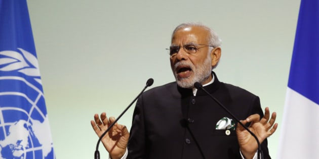 India's Prime Minister Narendra Modi addresses world leaders at the COP21, United Nations Climate Change Conference, in Le Bourget, outside Paris, Monday, Nov. 30, 2015. (AP Photo/Michel Euler)