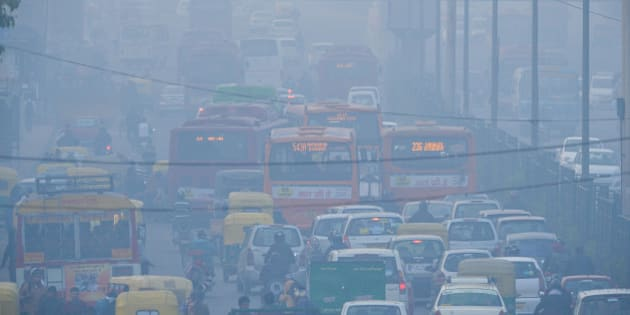 To go with India-environment-pollution,FOCUS by Trudy Harris In this photograph taken on December 18, 2015, Indian commuters travel on a polluted road near a bus terminus in the Anand Vihar District of New Delhi.  Anger and alarm are rapidly rising throughout sprawling New Delhi over the air quality that the World Health Organization (WHO) has ranked the most hazardous on the planet.  AFP PHOTO / CHANDAN KHANNA / AFP / Chandan Khanna        (Photo credit should read CHANDAN KHANNA/AFP/Getty Images)