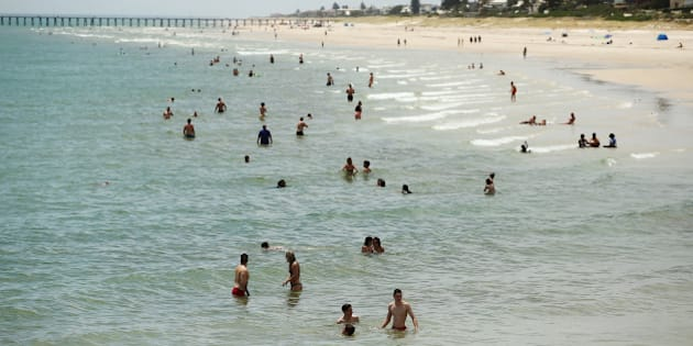 ADELAIDE, AUSTRALIA - DECEMBER 19:  Adelaide residents escape the heat at Henley beach on December 19, 2015 in Adelaide, Australia. Adelaide is experiencing an extreme heatwave, with temperatures reaching over 40 degrees for five consecutive days.  (Photo by Morne de Klerk/Getty Images)