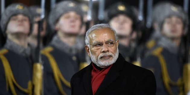 India's Prime Minister Narendra Modi reviews an honor guard during a welcoming ceremony at Moscow's Vnukovo II airport on December 23, 2015. Modi is on a two-day official visit to Russia. AFP PHOTO / ALEXANDER NEMENOV / AFP / ALEXANDER NEMENOV        (Photo credit should read ALEXANDER NEMENOV/AFP/Getty Images)