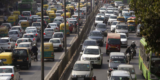 Cars and buses clogs a road in New Delhi, India, Wednesday, Dec. 16, 2015. India's top court Wednesday ordered a temporary ban on the sale of large diesel vehicles in and around New Delhi and slapped a stiff levy on trucks entering the capital as it struggles with record pollution. (AP Photo/Tsering Topgyal)