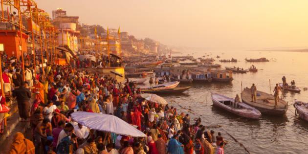 Hindus praying and bathing at the river Ganges, Varanasi at sunrise.