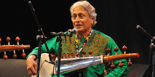 WILTSHIRE, UNITED KINGDOM - JULY 26: Amjad Ali Khan performs on stage at the Womad Festival at Charlton Park on July 26, 2014 in Wiltshire, United Kingdom. (Photo by C Brandon/Redferns via Getty Images)