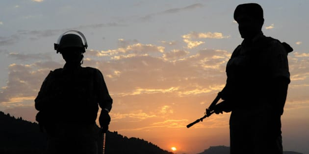 An Indian paramilitary soldiers stand guard as the sun sets over Dal Lake in Srinagar on June 20, 2011.  Indian Home Minister P Chidambaram has arrived for a two-day visit to Kashmir valley to review the overall security and political situation in the state, particularly measures being taken for the smooth and peaceful conduct of the 45-day-long Amarnath Yatra which is scheduled to start from June 29. The visit of Chidambaram has generated a renewed debate  about the Armed Forces Special Powers Act (AFSPA) and implementation of eight-point formula announced by the Home minister for Kashmir after the summer unrest which claimed the lives of more than 114 people.  AFP PHOTO/Rouf BHAT (Photo credit should read ROUF BHAT/AFP/Getty Images)