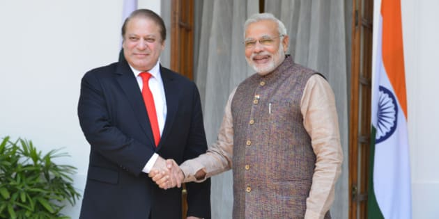 NEW DELHI, INDIA  MAY 27: Pakistani Prime Minister Nawaz Sharif shakes hands with Prime Minister Narendra Modi after the swearing-in ceremony of the NDA government in New Delhi on Tuesday, May 27, 1014.(Photo by Yasbant Negi/India Today Group/Getty Images)