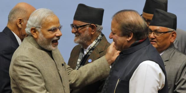Pakistani Prime Minister Nawaz Sharif, right, and Indian Prime Minister Narendra Modi shake hands during the closing session of the 18th summit of the South Asian Association for Regional Cooperation (SAARC) in Katmandu, Nepal, Thursday, Nov. 27, 2014. South Asian heads of state attending their first summit in three years reached a deal on energy sharing Thursday, but failed on two other economic agreements during a retreat where Indian and Pakistan leaders shook hands. (AP Photo/Niranjan Shrestha, Pool)