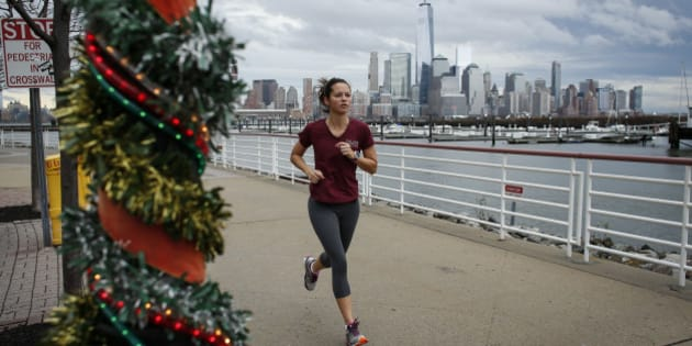 NEWPORT, NJ - DECEMBER 24: A woman jogs along the Hudson River shore on December 24, 2015 in Newport, New Jersey. New York and New Jersey have seen highs in the upper 50s this week, with temperatures expected to reach the low 70s on Christmas Eve. (Photo by Kena Betancur/Getty Images)