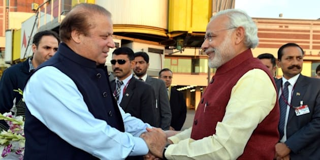 LAHORE, PAKISTAN - DECEMBER 25: Prime Minister of Pakistan Nawaz Sharif (L) shakes hands with Indian Prime Minister Narendra Modi (R) at Allama Iqbal International Airport in Lahore, Pakistan on December 25, 2015. (Photo by Indian Press Information office/Anadolu Agency/Getty Images)