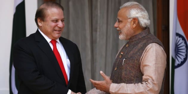 Indian Prime Minister Narendra Modi, right, shakes hand with his Pakistani counterpart Nawaz Sharif before the start of their meeting in New Delhi, India, Tuesday, May 27, 2014. Analysts say Sharif's visit could signal an easing of tensions between the often-hostile, nuclear-armed neighbors. No details were given about what the two men would discuss, but Modi is likely to ask Pakistan to hasten investigations into the Mumbai attack and put its perpetrators on trial. (AP Photo/Saurabh Das)