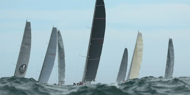 SYDNEY, AUSTRALIA - DECEMBER 26: Concubine and competitors race out to sea during the 2015 Sydney to Hobart on December 26, 2015 in Sydney, Australia.  (Photo by Cameron Spencer/Getty Images)